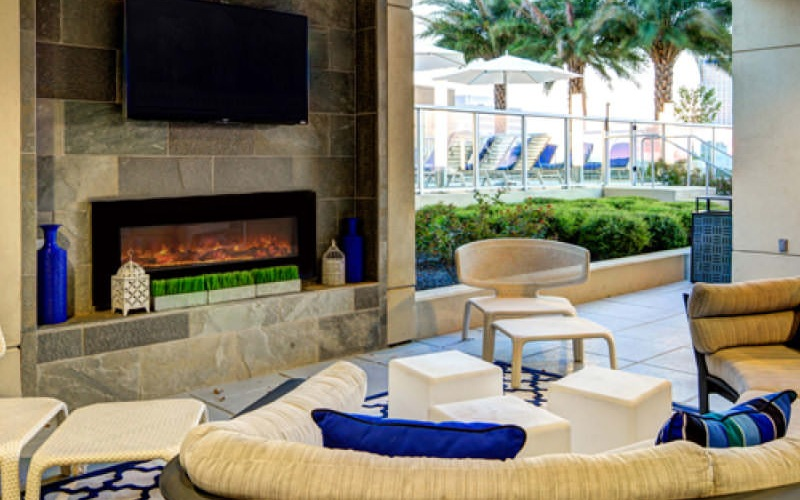 roofed outdoor patio with fireplace