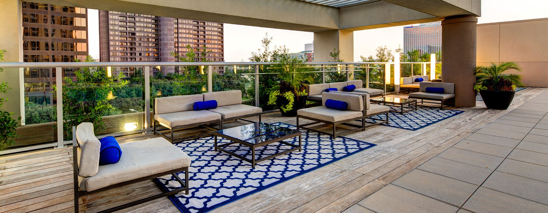 comfortable seating areas on rooftop lounge